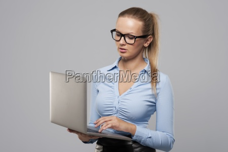 focus blonde businesswoman using modern laptop