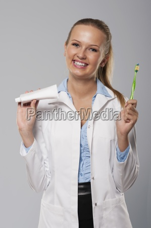 young female dentist with beautiful smile