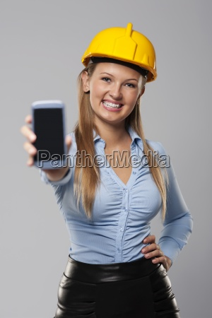 smiling architect woman showing screen of