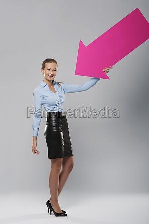 happy businesswoman with pink arrow