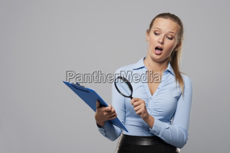 shocked woman looking at office documents