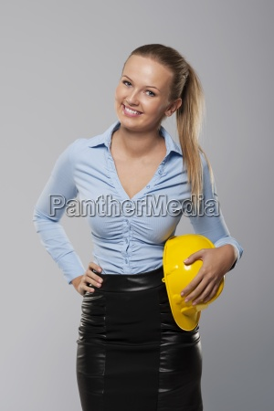 beautiful and smiling architect woman with