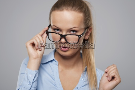 sexy blonde businesswoman with glasses