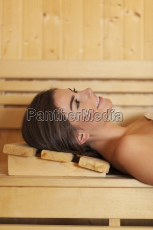 smiling beautiful woman resting in sauna