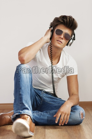 relaxed young man listening to music
