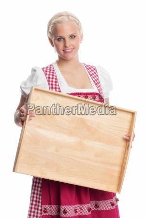 girl in dirndl holding tray