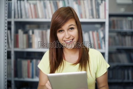 happy student using digital tablet in
