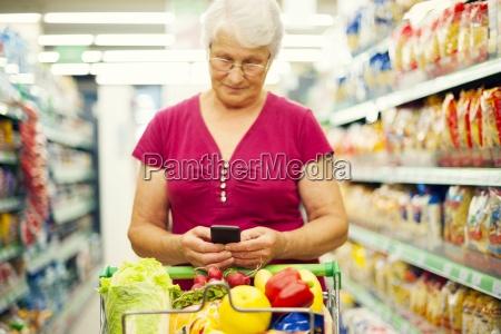senior woman texting on mobile phone