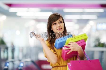 beautiful woman with credit card in