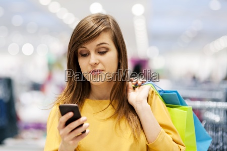 young woman texting on mobile phone