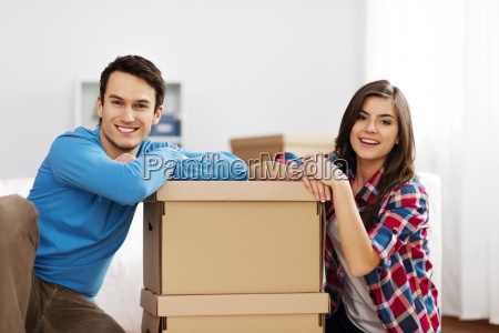 portrait of young couple with moving