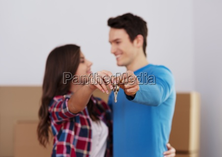 young couple holding key to new