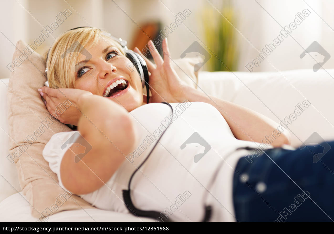 happy, woman, listening, to, music, on - 12351988