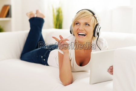 woman in living room listening music