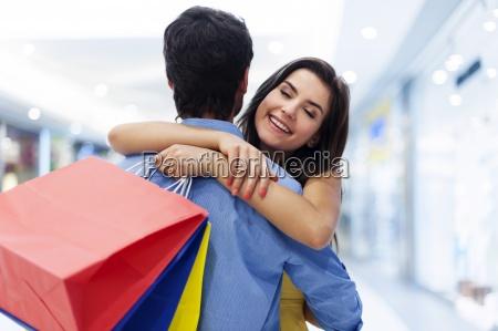 young beautiful woman welcoming in shopping