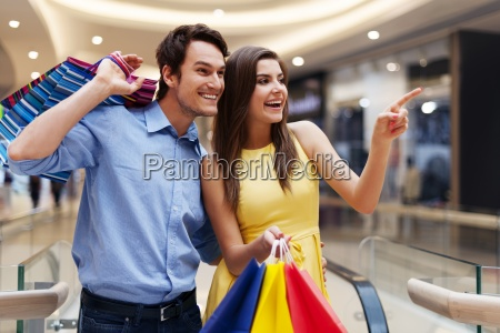 woman showing something in the shopping