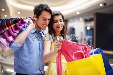 happy couple looking at a new