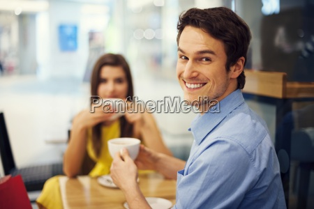 smiling handsome man at a meeting