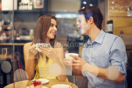 two people in cafe enjoying the