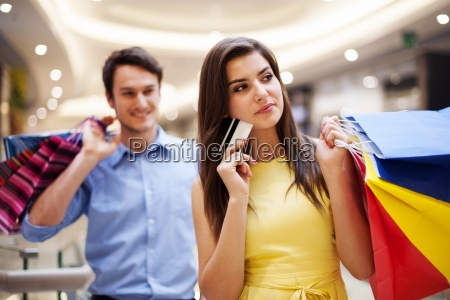 focus young woman holding credit card