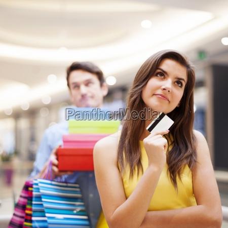 portrait of a dreaming female shopaholic