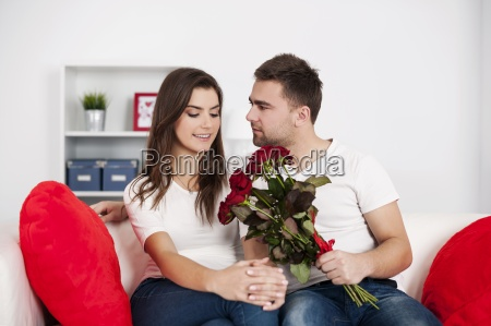loving couple with red roses