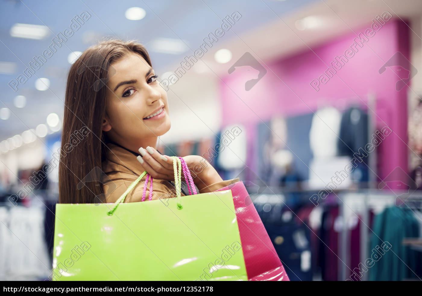attractive, woman, with, shopping, bags - 12352178