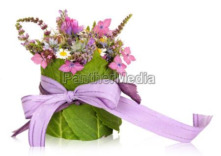 composizione floreale decorazione da tavola presente
