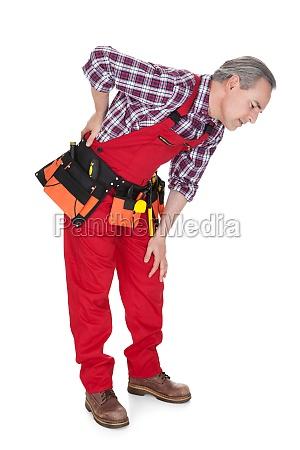 maschio tecnico soffrono di dolore al