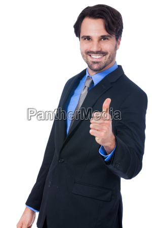 attractive young businessman thumbs up successful