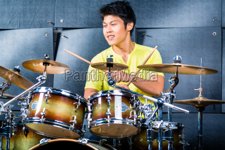 asian musician drummer in recording studio
