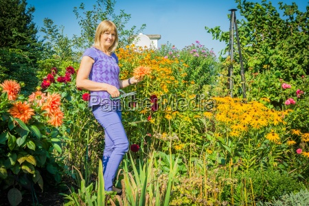 woman in garden with flowers