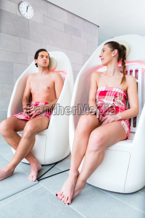 couple on infrared chairs at spa