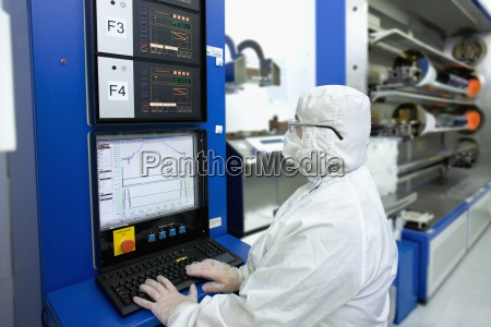engineer in clean suit working at