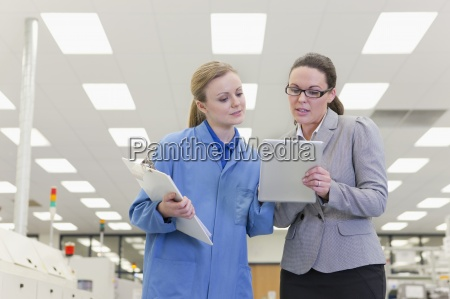 engineer and businesswoman looking down at