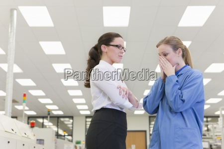 businesswoman talking to engineer with head