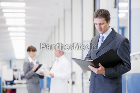 portrait of businessman reviewing paperwork in