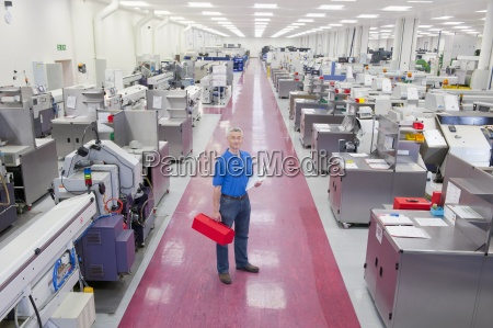 portrait of engineer with clipboard and