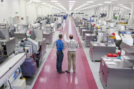 businessman and engineer in aisle of