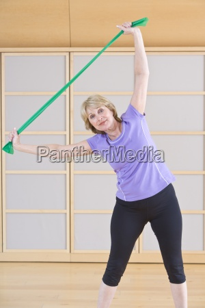 portrait of senior woman exercising with