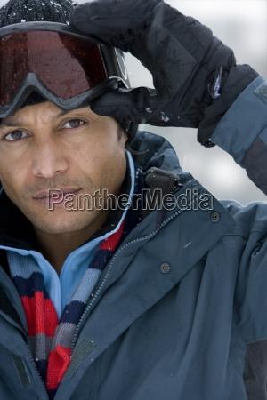 mature man wearing ski goggles close