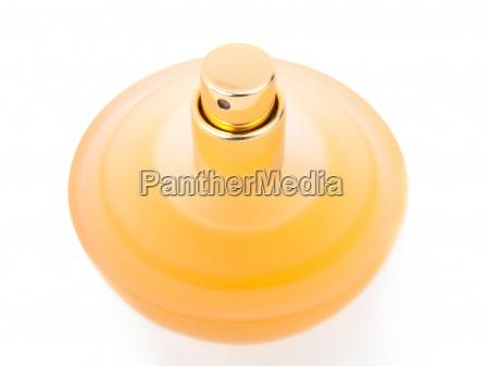 bella bottiglia gialla di profumo