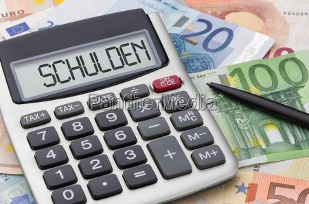 calcolatrice con banconote debito