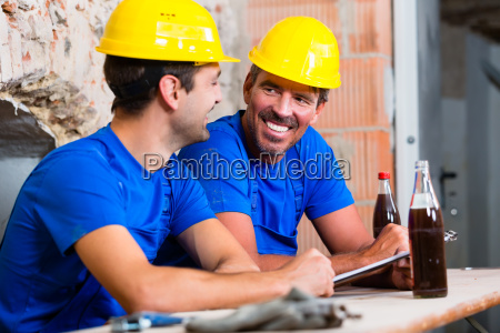 construction workers take a break at