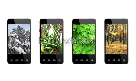 quattro smartphone con immagini colorate di