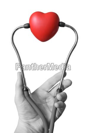mano con lo stetoscopio e il