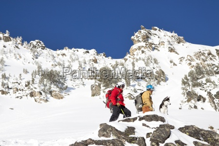 two male backcountry skiers and a