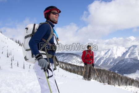 two male backcountry skiers near ymir
