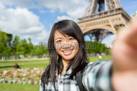 young attractive asian tourist in paris