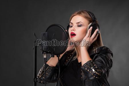 portrait of a beautiful woman singing